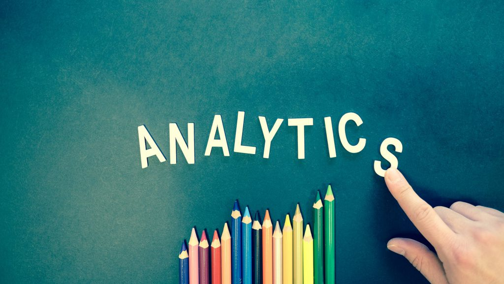 Marketing analytics consultant formed the word analytics on green board